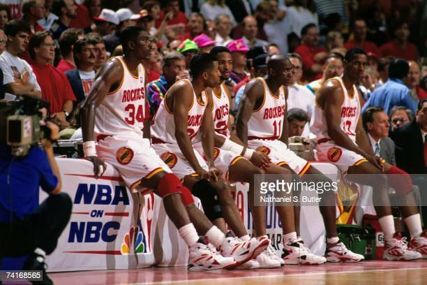 Hakeem Olajuwon Kenny Smith Robert Horry Vernon Maxwell and Otis Thorpe of the Houston Rockets wait at the scorers table during Game Seven of the NBA...