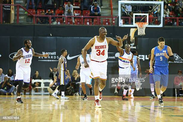 Hakeem Olajuwon of Team Africa scores against Nikola Vucevic of Team World during the NBA Africa Game 2015 as part of Basketball Without Boarders on...