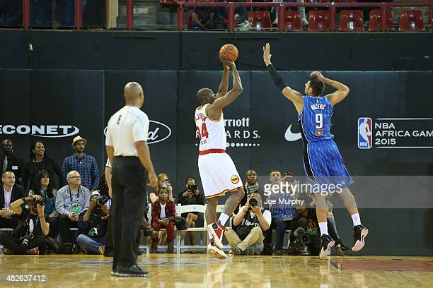 Hakeem Olajuwon of Team Africa shoots against Nikola Vucevic of Team World during the NBA Africa Game 2015 as part of Basketball Without Boarders on...
