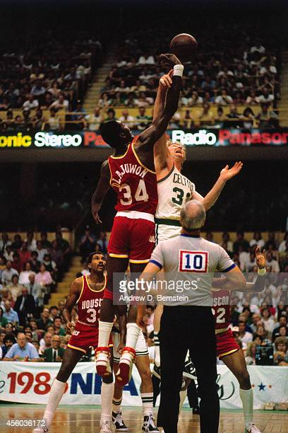 Hakeem Olajuwon of the Houston Rockets and Larry Bird of the Boston Celtics jump ball circa 1985 at the Boston Garden in Boston Massachusetts NOTE TO...