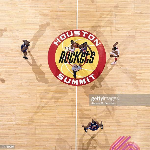 Hakeem Olajuwon of the Houston Rockets and Patrick Ewing of the New York Knicks jump for the opening tip off during Game One of the NBA Finals played...