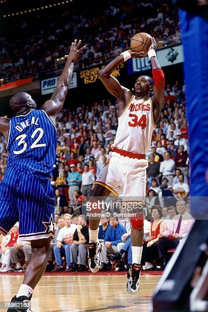 Hakeem Olajuwon of the Houston Rockets attempts a shot against Shaquille O'Neal of the Orlando Magic in Game Four of the 1995 NBA Finals at the...