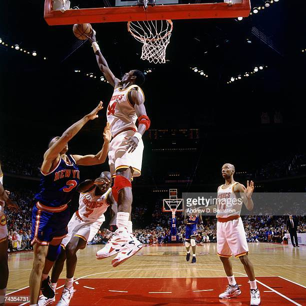 Hakeem Olajuwon of the Houston Rockets blocks a shot during Game Six of the NBA Finals played on June 19 1994 at the Summit in Houston Texas NOTE TO...