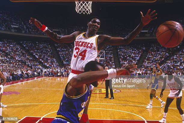 Hakeem Olajuwon of the Houston Rockets blocks a shot from the Utah Jazz at The Compaq Center in Houston Texas