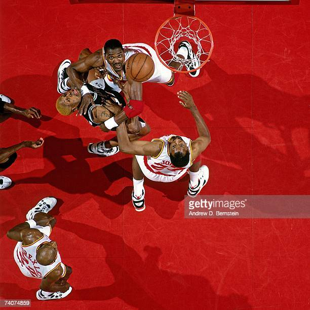 Hakeem Olajuwon of the Houston Rockets boxes out against Dennis Rodman of the San Antonio Spurs during game four of the Western Conference Finals on...