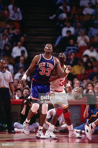 2b5d49053 Hakeem Olajuwon of the Houston Rockets boxes out against Patrick Ewing of  the New York Knicks