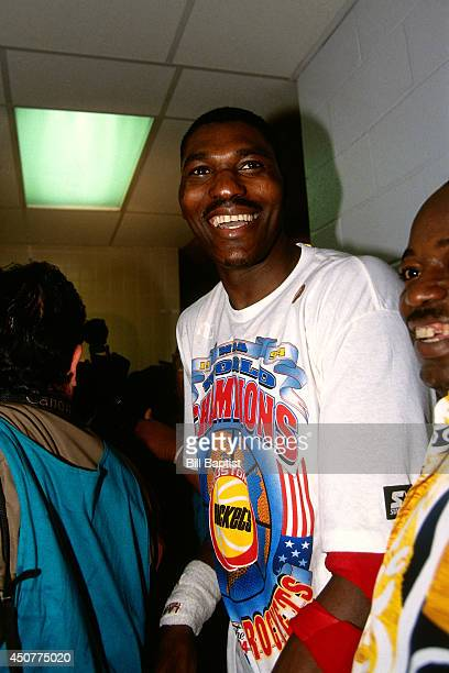 Hakeem Olajuwon of the Houston Rockets celebrates after winning Game Seven of the NBA Finals against the New York Knicks on June 22 1994 at The...