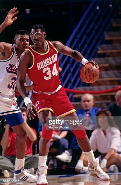 Hakeem Olajuwon of the Houston Rockets dribbles the ball against the Sacramento Kings circa 1991 at the ARCO Arena in Sacramento California NOTE TO...