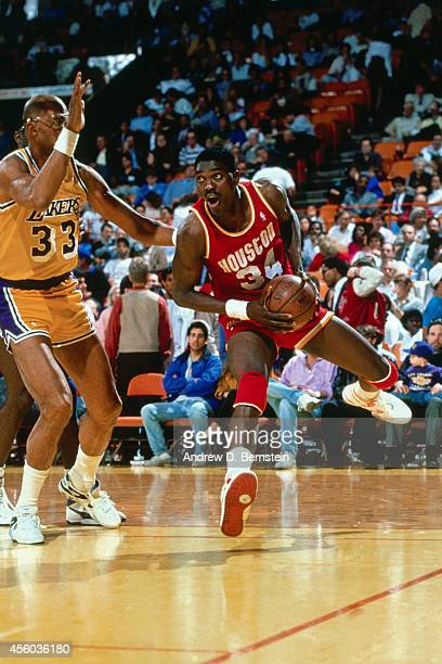 Hakeem Olajuwon of the Houston Rockets drives to the basket against Kareem AbdulJabbar of the Los Angeles Lakers circa 1989 at the Great Western...
