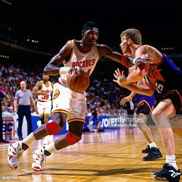 Hakeem Olajuwon of the Houston Rockets drives to the basket against Joe Kleine of the Phoenix Suns in Game Seven of the Western Conference Semifinals...