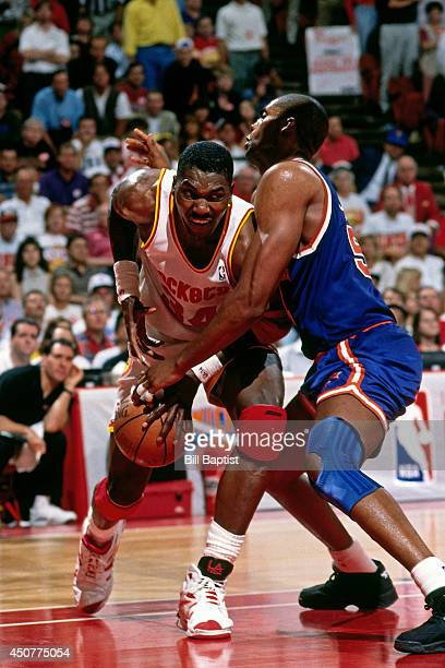Hakeem Olajuwon of the Houston Rockets drives to the basket during Game Seven of the NBA Finals against the New York Knicks on June 22 1994 at The...