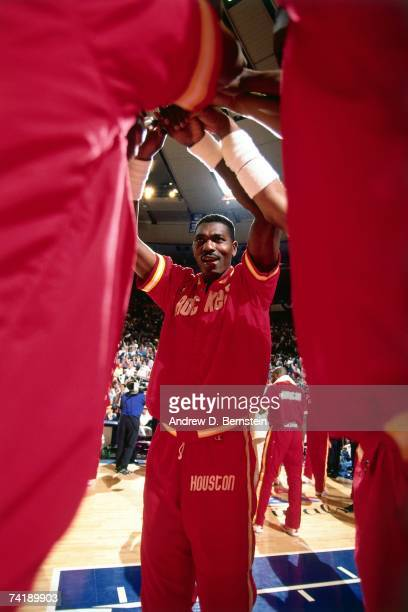 Hakeem Olajuwon of the Houston Rockets gathers with his teammates in the huddle against prior to Game Three of the NBA Finals played on June 12, 1994...