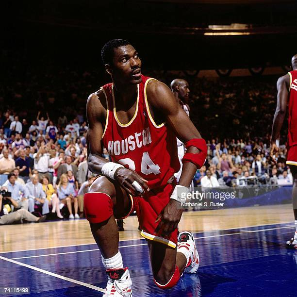 Hakeem Olajuwon of the Houston Rockets gets up from the floor during Game Five of the NBA Finals played on June 17 1994 at Madison Square Garden in...