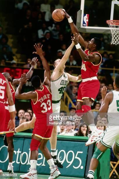 Hakeem Olajuwon of the Houston Rockets goes for a block against the Boston Celtics during the NBA game at Boston Garden circa 1995 in Boston...