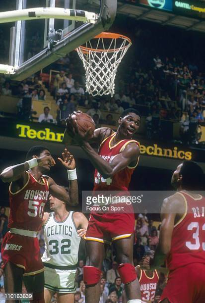 Hakeem Olajuwon of the Houston Rockets in action against the Boston Celtics during an NBA basketball game circa 1985 at the Boston Garden in Boston...