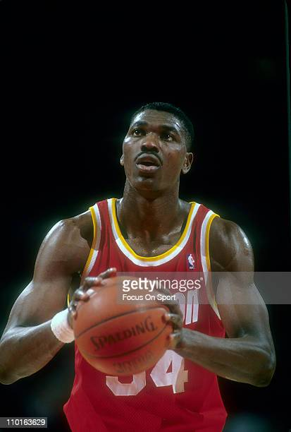 Hakeem Olajuwon of the Houston Rockets in action against the Washington Bullets during an NBA basketball game circa 1994 at the Capital Centre in...