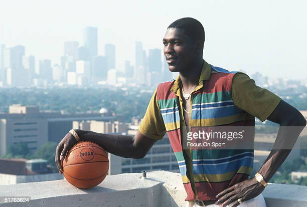 Hakeem Olajuwon of the Houston Rockets poses infront of the Houston skyline for a photo in Houston Texas