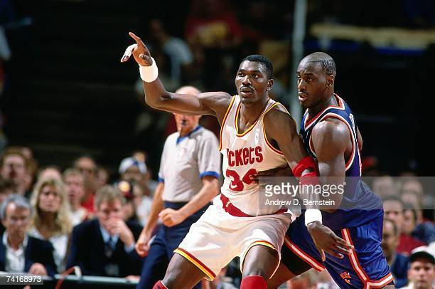 Hakeem Olajuwon of the Houston Rockets posts up against Anthony Mason of the New York Knicks during Game One of the NBA Finals played on June 8, 1994...