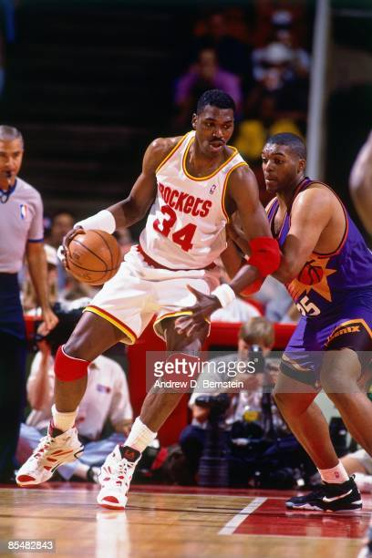 Hakeem Olajuwon of the Houston Rockets posts up against Oliver Miller of the Phoenix Suns during Game One of the Western Conference Semifinals played...