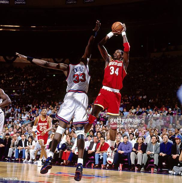 Hakeem Olajuwon of the Houston Rockets shoots against Patrick Ewing of the New York Knicks during Game Three of the NBA Finals played on June 12 1994...