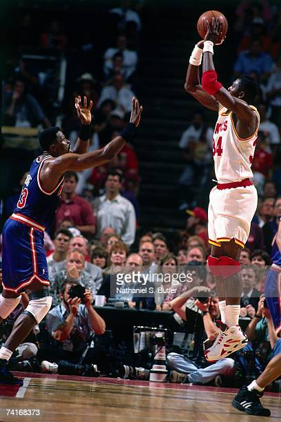 Hakeem Olajuwon of the Houston Rockets shoots against Patrick Ewing of the New York Knicks during Game Seven of the NBA Finals played on June 22 1994...