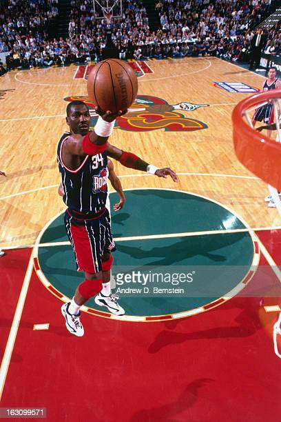 Hakeem Olajuwon of the Houston Rockets shoots against the Seattle Supersonics during Game Six of the Western Conference Semifinals as part of the...
