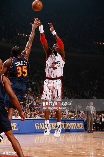 Hakeem Olajuwon of the Houston Rockets shoots over Erick Dampier of the Golden State Warriors during the game on November 22 1997 at the Compaq...