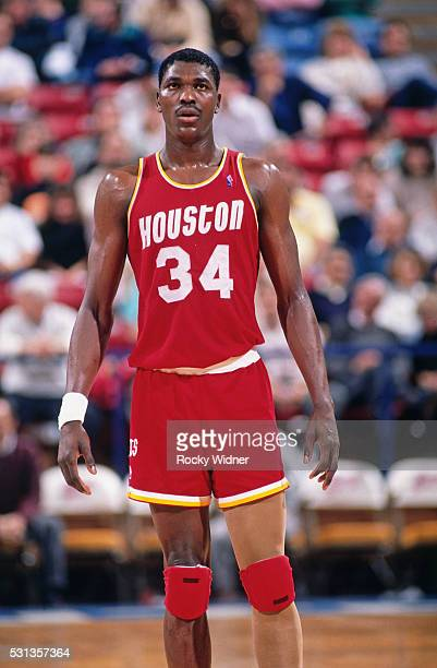 Hakeem Olajuwon of the Houston Rockets stands on the court against the Sacramento Kings circa 1990 at Arco Arena in Sacramento California NOTE TO...