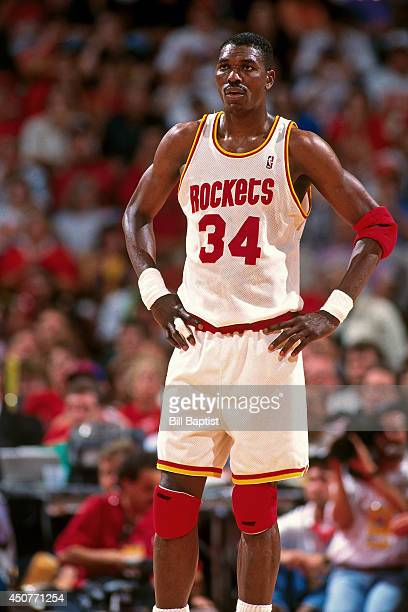 Hakeem Olajuwon of the Houston Rockets stands on the court during Game Two of the NBA Finals against the New York Knicks on June 10 1994 at The...