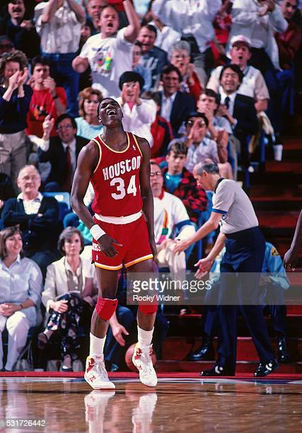 Hakeem Olajuwon of the Houston Rockets yells and celebrates as he runs up court during the game against the Sacramento Kings on April 4 1987 at Arco...