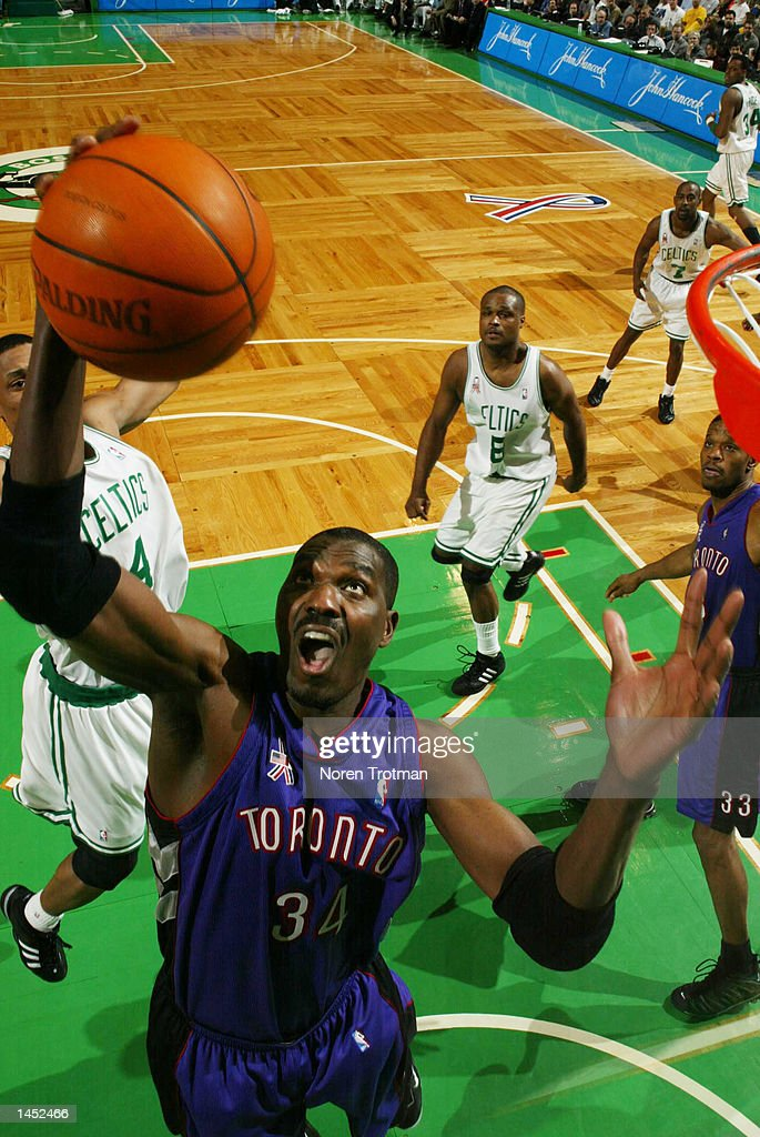 3f988a04ded2 Hakeem Olajuwon  34 of the Toronto Raptors grabs a rebound against the  Boston Celtics at