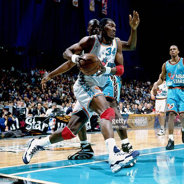 Hakeem Olajuwon of the Western Conference All Stars dribbles to the basket against Shaquille O'Neal of the Eastern Conference All Stars during the...