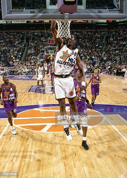 Hakeem Olajuwon of the Western Conference AllStars attempts a dunk against the Eastern Conference AllStars during the1995 NBA AllStar Game on...