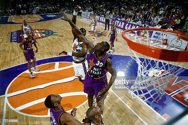 Hakeem Olajuwon of the Western Conference AllStars attempts a shot against Shaquille O'Neal of the Eastern Conference AllStars during the 1995 NBA...