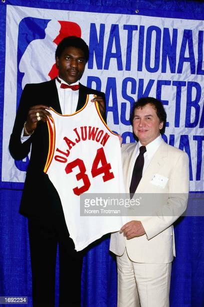 Hakeem Olajuwon#34 of the Houston Rockets poses with his new Rockets jersey after being selected in the first round in 1984 NOTE TO USER User...