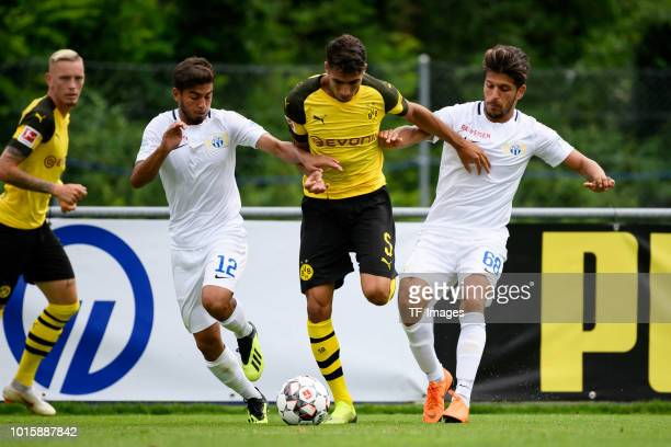 Hakim Guenouche of FC Zuerich Achraf Hakimi of Dortmund and Roberto Rodriguez of FC Zuerich battle for the ball during the friendly match between...