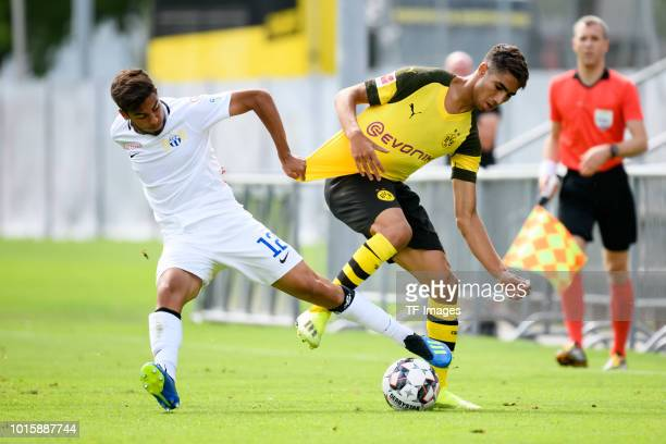 Hakim Guenouche of FC Zuerich and Achraf Hakimi of Dortmund battle for the ball during the friendly match between Borussia Dortmund and FC Zuerich on...