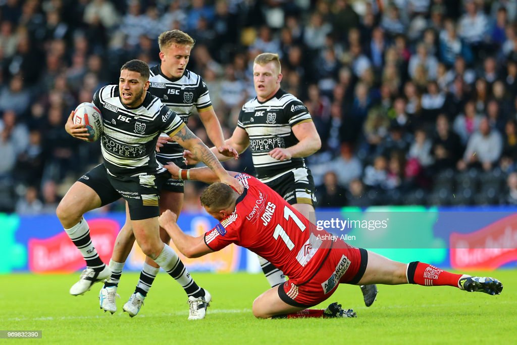 Hakim Miloudi of Hull FC (L) gets away from Josh Jones (R) of Salford Red Devils during the Betfred Super League match between Hull FC and Salford Red Devils at KCOM Stadium on June 8, 2018 in Hull, England.