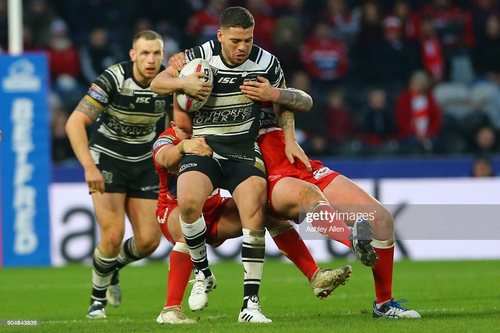 Hakim Miloudi of Hull FC is tackled by two Hull KR during the Clive Sullivan Trophy, pre-season friendly match between Hull FC and Hull KR at KCOM Stadium on January 14, 2018 in Hull, England.