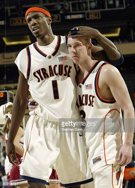 Hakim Warrick and Gerry McNamara of the Syracuse Orangemen walk off the court after losing to the Alabama Crimson Tide in the third round game of the...