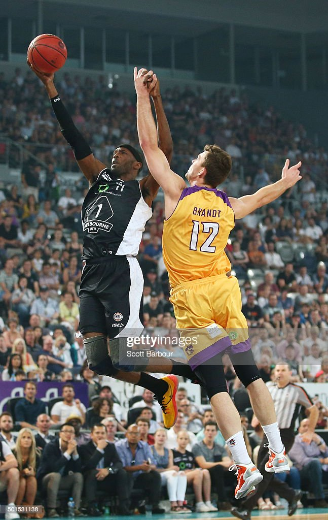 Hakim Warrick of Melbourne United drives to the basket as Angus Brandt of the Sydney Kings defends during the round 11 NBL match between Melbourne United and Sydney Kings at Hisense Arena on December 16, 2015 in Melbourne, Australia.
