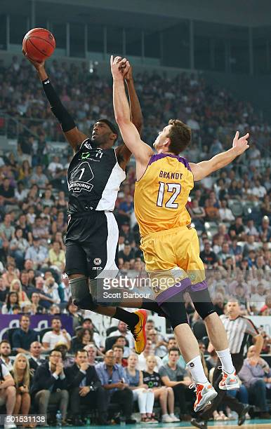 Hakim Warrick of Melbourne United drives to the basket as Angus Brandt of the Sydney Kings defends during the round 11 NBL match between Melbourne...