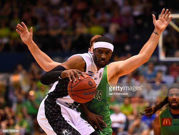 Hakim Warrick of Melbourne United looks to get past Mitch Norton of the Crocodiles during the round eight NBL match between the Townsville Crocodiles...