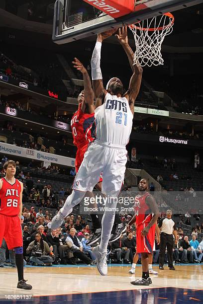Hakim Warrick of the Charlotte Bobcats drives to the basket against the Atlanta Hawks at the Time Warner Cable Arena on January 23 2013 in Charlotte...