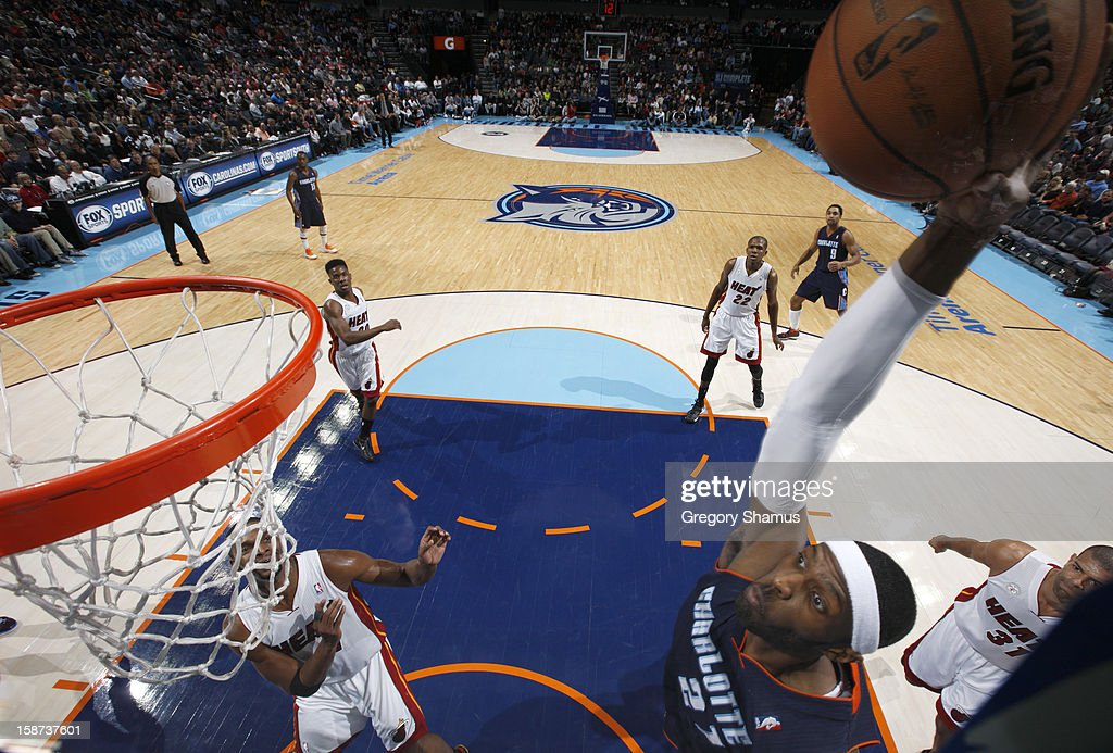Hakim Warrick #21 of the Charlotte Bobcats goes to the basket during the game between the Miami Heat and the Charlotte Bobcats at the Time Warner Cable Arena on December 26, 2012 in Charlotte, North Carolina.
