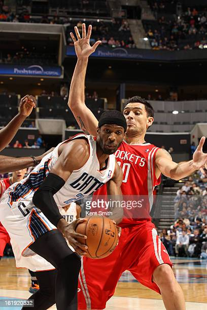 Hakim Warrick of the Charlotte Bobcats looks to pass the ball against Carlos Delfino of the Houston Rockets at the Time Warner Cable Arena on January...