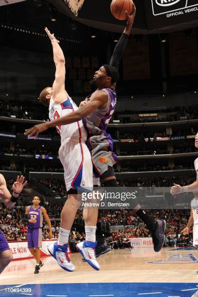 Hakim Warrick of the Phoenix Suns rises for a dunk against Blake Griffin of the Los Angeles Clippers at Staples Center on March 20 2011 in Los...