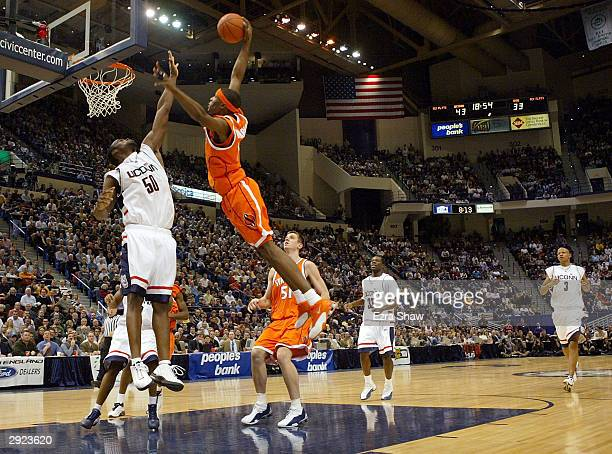 Hakim Warrick of the Syracuse Orangemen attempts a dunk over Emeka Okafor of the UCONN Huskies on February 2 2004 at the Hartford Civic Center in...