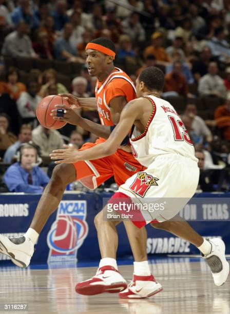 Hakim Warrick of the Syracuse Orangemen drives inside against Chris McCray of the Maryland Terrapins during their second round game of the NCAA...