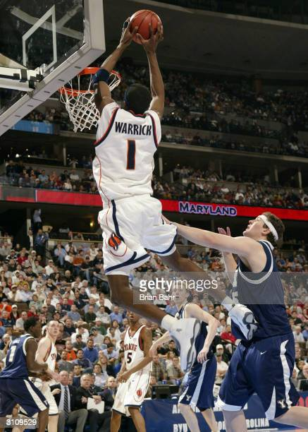 Hakim Warrick of the Syracuse Orangemen dunks against Jake Shoff of the BYU Cougars during their first round game of the NCAA Division I Men's...